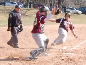 Naugatuck's Adam Tavares slides into to home to score the go-ahead run Monday versus Sacred Heart at Fulton Park in Waterbury. The Greyhounds beat the Hearts, 8-3, to earn their first win of the year. –KEN MORSE