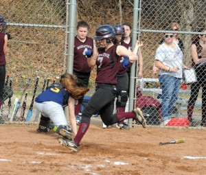 Naugatuck's Kara Klimaszewski scores against Kennedy April 10 at Breen Field in Naugatuck. The Greyhounds won the game, 4-3. The next day the Greyhounds swept a doubleheader against Wilby by a combined score of 33-0 and are 6-1 through the first seven games of the year. –LUKE MARSHALL
