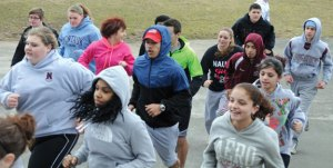 The Naugatuck High School boys and girls track team run hills during practice late last month at the school. The team will look to blend new faces with returning athletes to maintain its consistency of winning in the Naugatuck Valley League. –LUKE MARSHALL