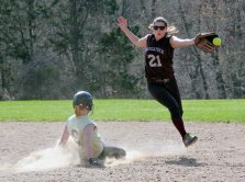 Woodland's Cameron Caswell (9) steals second as Sarah Chandler (21) of Naugatuck reaches out to try to snag the throw Monday afternoon in Beacon Falls. The Hawks rallied to win the game, 5-4, in eight innings. –ELIO GUGLIOTTI