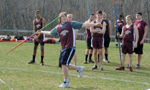 Naugatuck's James San Angelo throws the javelin as his teammates look on during a track meet Tuesday at Woodland Regional High School in Beacon Falls. –LUKE MARSHALL