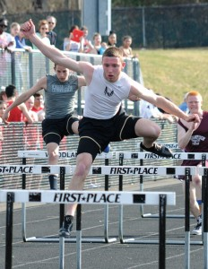 Woodland's James Giacomaczi, front, leaps over a hurdle Tuesday during a meet in Beacon Falls against Naugatuck, Wolcott and Sacred Heart. The Hawks swept the meet. –LU KE MARSHALL