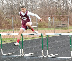 Naugatuck's Isaque Montiero runs away from the field in the 300 hurdles during a track meet Tuesday versus Holy Cross, Crosby and St. Paul in Waterbury. Naugatuck won the boys and girls meet. –KEN MORSE