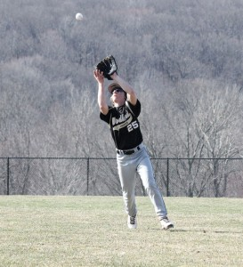 Woodland second baseman Joe Poeta hauls in a pop fly Monday afternoon versus Seymour in Beacon Falls. The Hawks fell to the Wildcats, 2-1. –ELIO GUGLIOTTI