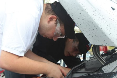 Ryan Livolsi of Naugatuck, left, and Daniel Tatun of Shelton seniors at Emmett O'Brien Technical High School work to de-bug a Ford Focus during the recent AAA/Ford Student Auto Skills Competition at The Holiday Inn in North Haven. The pair won third place in the competition. –CONTRIBUTED