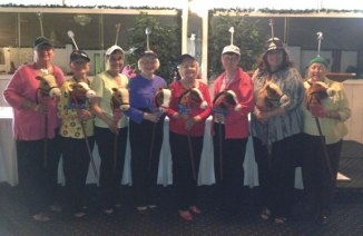 From left, Dot Evon riding Dotties' Dream, Mary Ruszczyk riding Smitty, Mary Oliveira riding Mary Mischief, Barbara Dumonski riding Terrible Ted, Dot Smith riding Footloose, Janet Aresta riding Jan's Juggernut, Anna Bratsis riding Run-A-Way Sue, and Janet Conroy riding This Way Out, pose for picture during the Naugatuck Woman's Club's Kentucky Derby luncheon May 6 at the Continental Room in Naugatuck. The luncheon featured mint juleps, a 'horse' race, and club members donning hats in honor of the Derby. –CONTRIBUTED