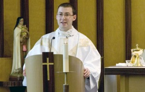 Rev. Michael Casey of Prospect gives a mass at St. Mary´s Hospital in Waterbury Monday. The Archdiocese ordained seven new priests recently including Rev. Casey and Rev. John Mariano of Naugatuck. –RA ARCHIVE