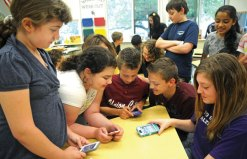 Cross Street Elementary School sixth-graders, from left, Zoey Kennedy, Briana Morganstern, Justin Papp, Tony Lope, and Stephanie Tucci play with their smart phones at the end of the school day May 22. Tucci, who is part of the student council, organized an electronics day to raise money for the Coachman Square at Woodbridge's team in the Walk to End Alzheimer's in September. Tucci's mother Christine works at Coachman Square and is part of the team taking part in the walk. Students were allowed to bring electronic items to school and play with them at the end of the day if they donated $1. The event raised $171 for the walk. –LUKE MARSHALL