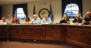Mayor Robert Chatfield, fourth from the right, and the Town Council discuss ways to trim the 2013-14 town budget proposal during a workshop Tuesday night in Town Hall. –LUKE MARSHALL