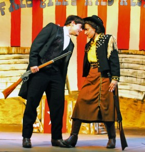 Zachary Carter, left, and Alex Hernandez rehearse a scene from Naugatuck Teen Theater's production of 'Annie Get Your Gun' Monday night at St. Michael's Church in Naugatuck. Carter is playing Frank Butler and Hernandez is playing Annie Oakley in the musical set against the backdrop of Buffalo Bill's Wild West Show. The show opens 8 p.m. May 4 at St. Michael's Church Hall. –LUKE MARSHALL