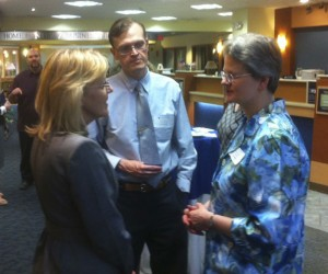 Sharon Mansfield of Literacy Volunteers of Greater Waterbury, left, talks with Kirk Morrison and Jocelyn Miller of the Howard Whittemore Memorial Library in Naugatuck Wednesday night during the Naugatuck Savings Bank Foundation's Community Awards Program grants reception.