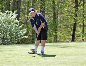Woodland's Mike Erickson putts on the first hole at Hop Brook Golf Course in Naugatuck Monday afternoon. Erickson led the Hawks against Naugatuck by shooting a 42. The Greyhounds won the match, 171-188. –ELIO GUGLIOTTI