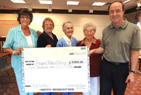 Prospect Library Director John Wiehn, right, accepts a $2,000 donation from the Friends of the Prospect Library recently. Wiehn was presented the check by Friends members, from left, Ailine Waldmann, Marge Fiske, Joyce Blinstrubas and Elaine Pizzuto. -CONTRIBUTED