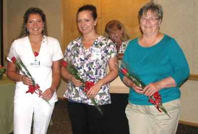 Griffin Hospital nurses, from left, Kathryn Dibona, RN, of Naugatuck, Paulina Jaworski, RN, and Maureen Smith, RN, of Beacon Falls were named 2013 Nightingale Award for Excellence in Nursing winners.The Nightingale Awards program recognizes nurses throughout Connecticut for their dedication, commitment and generous contributions to the field of nursing. Fabrizi, a staff nurse at Masonicare at Newtown in Newtown, was honored at a special awards dinner May 9 at the Stamford Marriott Hotel & Spa. Dibona and Smith, who both work at Griffin Hospital in Derby, were recognized during the hospital's Nurses' Week luncheon and awards ceremony recently. Dibona also earned Griffin Hospital's Outstanding Nurse of the Year Award.Dibona has worked at the hospital for 11 years starting as a member of the distribution department before becoming certified as a multi-skilled technician and then as a registered nurse. She is currently a night-shift nurse on the hospital's telemetry unit. -CONTRIBUTED