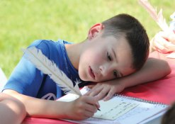 Algonquin School third-grader Colin Slavin rests his head as he writes with a quill pen Town Green May 30. Third-graders from the school in Prospect stepped back in time to learn about the town and its history. The students toured Town Hall, Prospect Cemetery, the Center One schoolhouse and the Hotchkiss House and barn. As part of the day, students wrote with quill pens and played games from yesteryear. The program was organized by third-grade teachers Marcia Beltrami, Elena Guerra and Kathleen Bicio and the Prospect Historical Society. The program was funded through the Region 16 innovative grant initiative. The program ties into the state's social studies standards and the students will be creating a history book about Prospect for children. –ELIO GUGLIOTTI