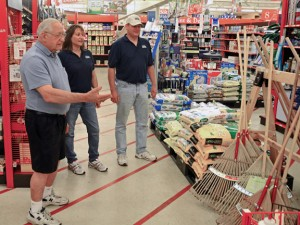 Ed Taranovich, left, owner of Ed's Do it Best Hardware in Naugatuck, shows his daughter and son-in-law, Tracey and Bob Dillistin, around the store June 13 Taranovich, who has owned the store for 37 years, is selling it to the Dillistins in July. LUKE MARSHALL