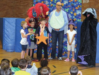 Hop Brook Elementary School kindergarteners and members of the Interactive Educational Theatre perform a skit at the school June 10. The theatre performed at multiple elementary schools in Naugatuck this week funded through a grant from Naugatuck Youth and Family Services. –LUKE MARSHALL
