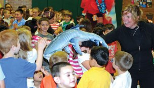 Interactive Educational Theatre Executive Director Magda Skomal shows Hop Brook Elementary School kindergartners a shark stuffed animal that was used in the theatre's skit about underwater diversity at Hop Brook June 10. The purpose of the skit was to teach students that even though someone doesn't look the same as them, they can still be friends and help each other out. The theatre performed at multiple elementary schools in Naugatuck this week funded through a grant from Naugatuck Youth and Family Services. –LUKE MARSHALL
