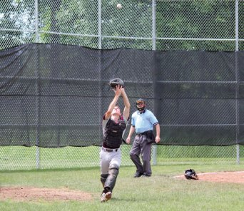 Post 17 catcher John Dean hauls in a pop up Sunday during the first game of a doubleheader against Posts 194-25 at Woodland Regional High School in Beacon Falls. Post 17 swept the doubleheader with 5-0 and 12-8 wins. –ELIO GUGLIOTTI
