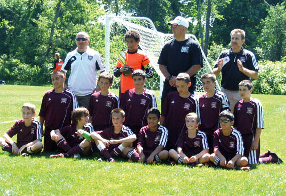 The Naugatuck Youth Soccer U12 boys won a co-championship at the CT Cup in their age division. The game took place June 15 in Farmington. Pictured, sitting from left, Michael Salomoni, Alex Teixeira, Jake Corbo, Arthur Tomaz, Logan Martin and Andres Maldonado. Kneeling from left, Carlos Gonzaga, Christian Jacobi, Justin Simoes, Andrew Mahler, Thomas Martins and Rami Fayad. Standing from left, assistant coach George Martin, Aren Seeger, coach John Jacobi and assistant coach Mark Salomoni.-CONTRIBUTED
