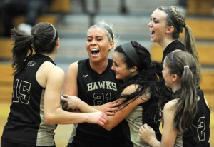 Woodland senior Tayler Boncal (21) celebrates with her teammates during a volleyball game in the fall. Boncal was named the NVL Female Senior Athlete of the Year. –RA ARCHIVE