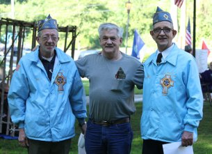 Members of Catholic War Veterans Post 708 pose for a picture during the vigil. The Post is open to veterans who are Catholics in good standing. The Post meets the second Wednesday of the month at the Naugatuck Polish Club at 7 p.m. Meetings are not held in July and August. Burgess Pat Scully, left, is the commander of the Post. –ELIOGUGLIOTTI