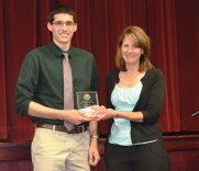 Naugatuck resident Joseph Carlson, a business administration major at Springfield College, left, receives the Department Graduating Senior Award for the Business Administration Department recently from Springfield College Business and Administration Professor Brenda Canning. This award is given to the graduating senior selected by the faculty members of their respective department for their dedication to academic excellence, their contributions to the intellectual life of the college community and for their commitment to the humanics ideals of the college. –CONTRIBUTED