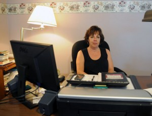 Naugatuck Youth and Family Services Acting Director Christina Koch Gamble sits in her office on Tuesday. –LUKE MARSHALL