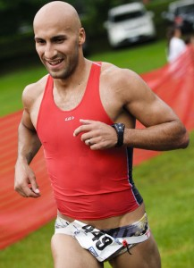 Karim Mabrouk finishes in second during the 26th Annual Pat Griskus Sprint Triathlon Wednesday night. The event consisted of a half mile swim at Lake Quassapaug, a 10.5 mile bike around the lake and a 3.1 mile run.  –RA ARCHIVE