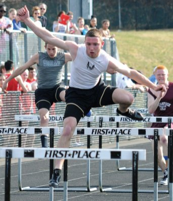 Woodland Regional High School's James Giacomaczi leaps over a hurdle during a track and field meet this spring. The Hawks boys and girls teams won three out of four NVL track titles. –FILE PHOTO