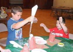 The Beacon Falls Library hosted a craft project July 8 at St. Michael's Lyceum where children constructed volcanoes out of a water bottle and clay and then set them off using baking soda and vinegar. –LUKE MARSHALL