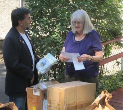 Daniel Whitman of Naugatuck, an Odd Fellow Brother of the Odd Fellows Nosahogan Lodge 21 in Waterbury, delivers baby blankets, baby items and monetary donations to Carolyn's Place Director Ellen Cavallo in Waterbury recently on behalf of the lodge. -CONTRIBUTED