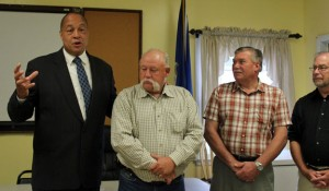 Beacon Falls Republican First Selectman Gerard Smith, left, talks about Republican Selectman David D'Amico, second from the right, who will not seek re-election Saturday at the Beacon Falls Senior Center. Beacon Falls Town Clerk Leonard Greene Sr. and Town Treasurer Mike Krenesky look on. –ELIO GUGLIOTTI