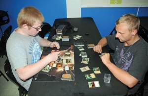 Naugatuck residents Justin Pickering, 17, and Luke Drury, 17, play a round of Magic: The Gathering Aug. 5 at Snap Keep Games on Church Street in Naugatuck. Snap Keep Games was opened by Matthew Kelley of Waterbury in May. -LUKE MARSHALL