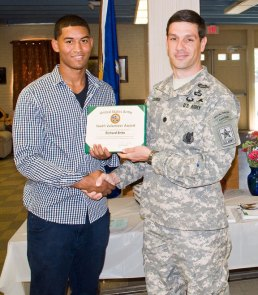 Richard Brito of Naugatuck receives the U.S. Army Youth Volunteer Award from Lt. Col. Michael Coleman, commander of the U.S. Army Recruiting Battalion in Albany, N.Y., Aug. 6 at the Naugatuck Senior Center. –LUKE MARSHALL