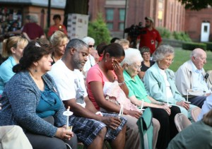 Laura Suazo, center, and her husband, Andre Suazo, listen to a song in honor of, William Smolinski Jr., a Waterbury man who has been missing for nine years, during a vigil on the Naugatuck Town Green Sunday. Laura Suazo's son, Andrew Garcia, has been missing since October 2011. –RA ARCHIVE