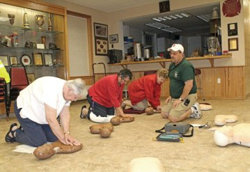 Peter Monti, an EMT with Beacon Hose Company No. 1, teaches CPR during the Save a Life Saturday event Aug. 24 at the firehouse in Beacon Falls. Beacon Hose officials trained 110 people in child and adult CPR over 12 hours. -CONTRIBUTED