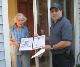 Prospect Grange President Timothy Meehan, right, presents Doris Welton, a longtime resident of Prospect, with a 75 year membership award. Welton and her late husband, Joseph, joined Prospect Grange in April 1937. They were very active for many years. Welton keeps active in her gardens around her home every day in good weather. –CONTRIBUTED