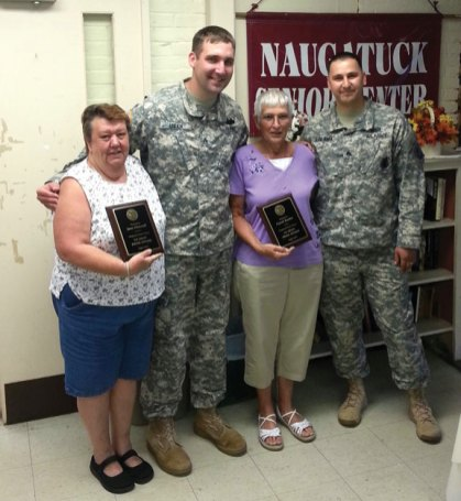 U.S. Army sergeants Curtiss Howard Leilich and Nathan Leo DeBaca present June Ottowell, left, and Carol Butler both of Naugatuck, with the U.S. Army Citizen Service Award for 2013 Aug. 20 at the Naugatuck Senior Center. The Army recognized Butler and Ottowell for 10 years of voluntary work at the senior center, including their creative efforts on the center's annual Holiday Bazaar. –CONTRIBUTED