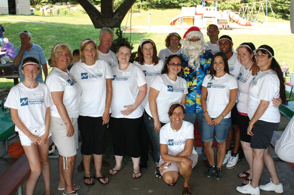 Volunteers from Naugatuck Valley Savings and Loan helped out at a Special Olympics Connecticut Northwest Region Christmas in July themed dance for athletes at Veterans Memorial Park in Watertown on July 21. Naugatuck Valley Savings and Loan set up a craft table for athletes to make their own sun visors with members of the bank. –CONTRIBUTED