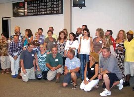 Former Hillside Middle School teachers Fred and Jeanne Scheithe hosted a 'no class' reunion for classes from the 1970s, 1980s, 1990s and 2000s at the Naugatuck Elks Lodge Aug. 17. Pictured, members of the Hillside classes of the 1970s come together for group photos. –CONTRIBUTED