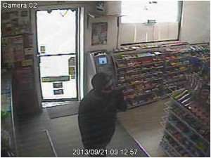 Police released this surveillance photo of the suspect in an armed robbery Saturday at the Stop and Save at 168 Spencer St. in Naugatuck. –CONTRIBUTED