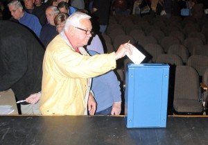 Beacon Falls resident John Sikora casts his vote during a town meeting Monday night at Woodland Regional High School. –LUKE MARSHALL