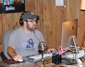 Naugatuck resident and host of the Super Duper Nerd Squad Podcast Jay Labansky adjusts the sound prior to the recording of an episode of the podcast last month. –LUKE MARSHALL