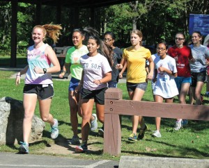 Naugatuck High seniors Madison Beasley (front left) and Caitlyn Colella (front right) lead the girls cross country team on a run during practice Sept. 6 at Hop Brook State Park in Middlebury. –ELIO GUGLIOTTI