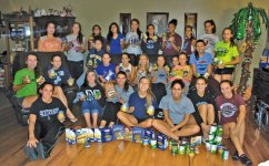 The Naugatuck High School volleyball team recently collected canned goods and donated them to the Ecumenical Food Bank on Spring Street in Naugatuck. -CONTRIBUTED