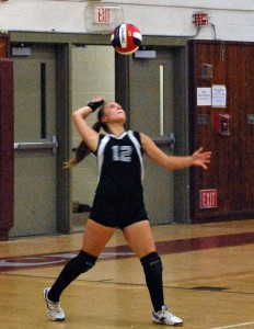 Naugatuck's Kara Klimaszewski serves Tuesday night at home against Torrington. The Greyhounds fell to the Red Raiders, 3-1. –KEN MORSE