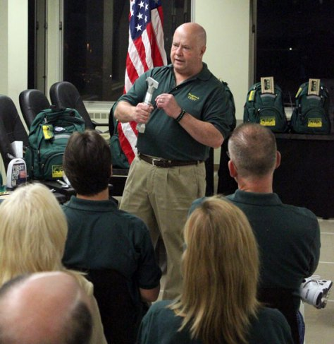 Naugatuck's Emergency Management Director Francis Dambowsky discusses the use of an emergency tool Monday night in Town Hall before a ceremony to swear in 19 new members of Naugatuck's Community Emergency Response Team. –ELIO GUGLIOTTI