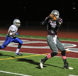 Naugatuck's Ryne Griesenauer (6) hauls in a catch to set the Greyhounds up at the 2 yard line Oct. 18 at home against Bunnell. The Greyhounds beat Bunnell, 39-0. –ELIO GUGLIOTTI
