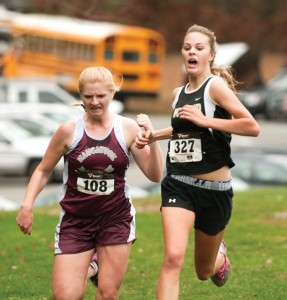 Naugatuck's Madison Beasley, left, and Woodland's Mary Sardinskas battle for second place during the NVL cross country championships Oct. 16 at Veterans' Park in Watertown.  Sardinskas edged out Beasley for second place and led the Hawks to their first title since 2009. –RA ARCHIVE